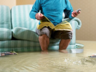 Man in flooded room