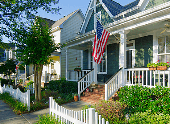 Front porch of a home that has an American flag displayed