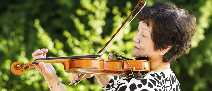 Elderly woman playing violin