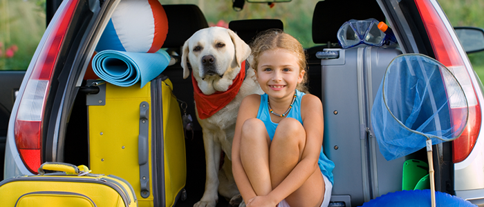 Girl and dog in back of car